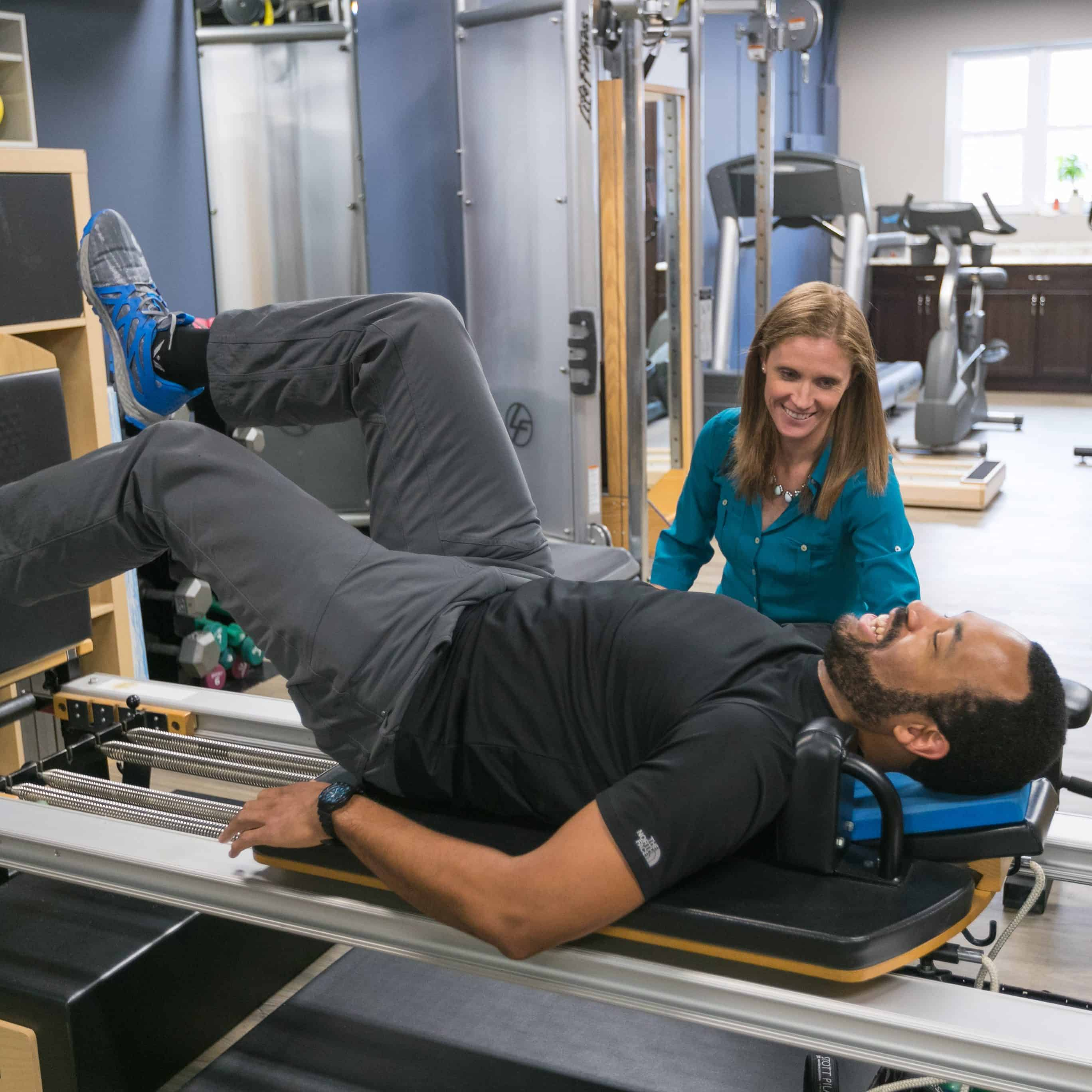 Annika Michaels, PT, DPT works with a patient